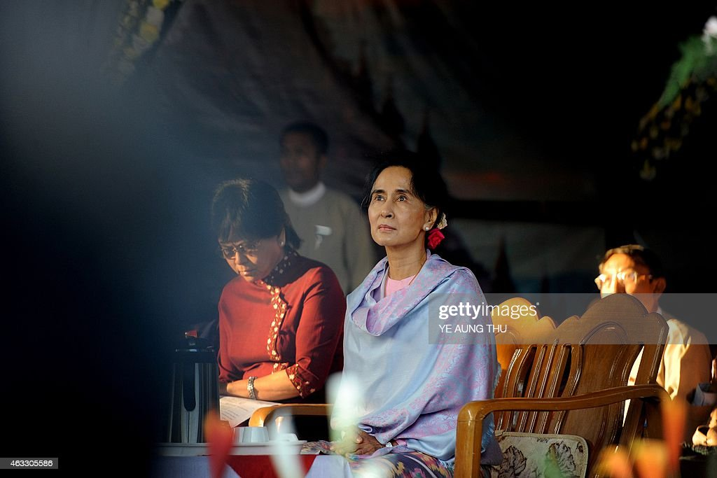 Myanmar opposition leader <a gi-track='captionPersonalityLinkClicked' href=/galleries/search?phrase=Aung+San+Suu+Kyi&family=editorial&specificpeople=214208 ng-click='$event.stopPropagation()'><a gi-track='captionPersonalityLinkClicked' href=/galleries/search?phrase=Aung+San&family=editorial&specificpeople=812845 ng-click='$event.stopPropagation()'>Aung San</a> Suu Kyi</a> (C) is pictured after arriving to attend a ceremony to mark the 100th birthday of her father, independence hero <a gi-track='captionPersonalityLinkClicked' href=/galleries/search?phrase=Aung+San&family=editorial&specificpeople=812845 ng-click='$event.stopPropagation()'>Aung San</a>, in the remote central Myanmar town of Natmauk on February 13, 2015. Known affectionately as 'Bogyoke', or General, <a gi-track='captionPersonalityLinkClicked' href=/galleries/search?phrase=Aung+San&family=editorial&specificpeople=812845 ng-click='$event.stopPropagation()'>Aung San</a> is adored in Myanmar and credited with unshackling the country from colonial rule and embracing its ethnic minorities in a vision of unity that unravelled catastrophically in the military-dominated decades that followed his 1947 assassination.