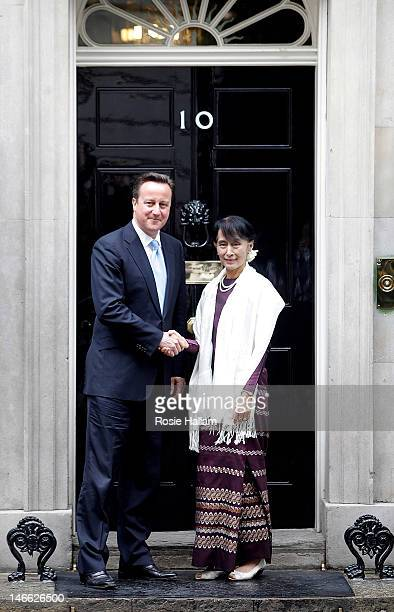 Myanmar opposition leader Aung San Suu Kyi shakes hands with British Prime Minister David Cameron as she arrives for a meeting at 10 Downing Street...