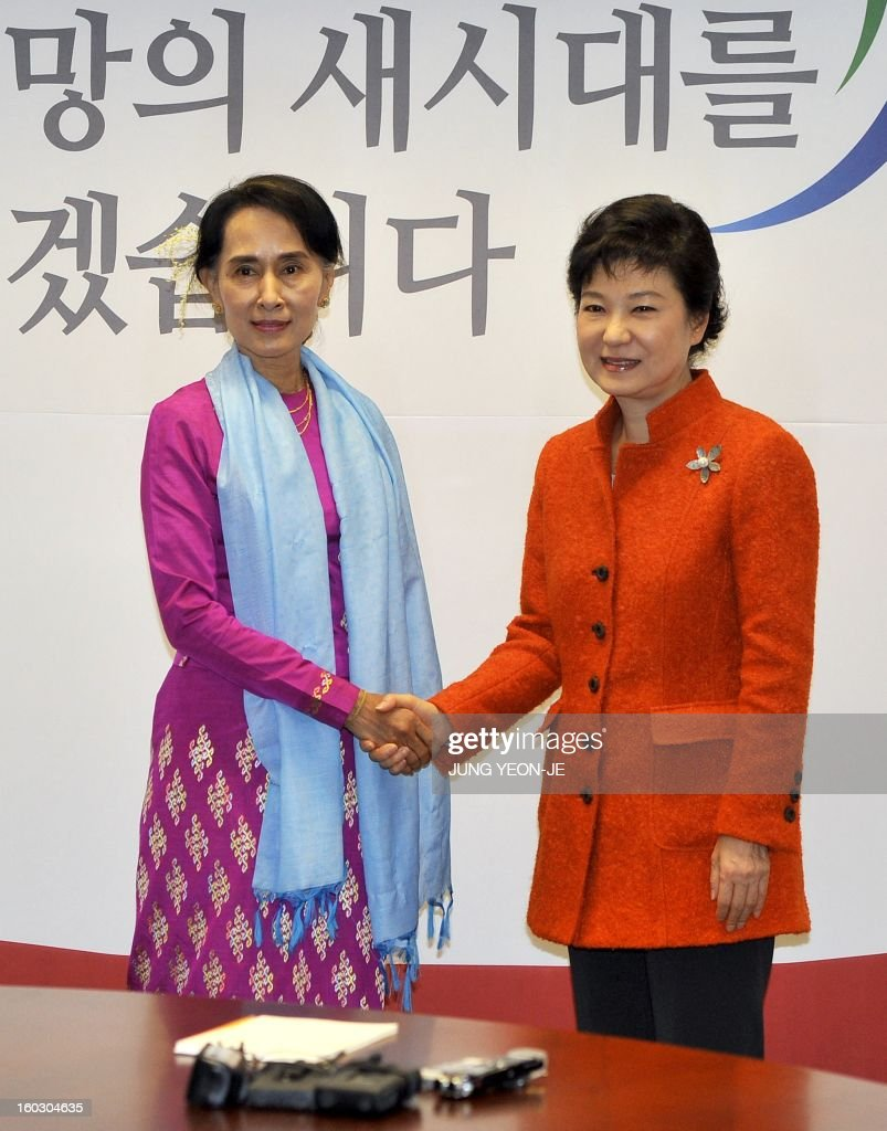 Myanmar opposition leader Aung San Suu Kyi (L) shakes hands with South Korean president-elect Park Geun-Hye (R) during their meeting in Seoul on January 29, 2013. Suu Kyi arrived in South Korea on January 28 for a four-day visit including meetings with politicians and a soap-opera star and the collection of a human rights award.
