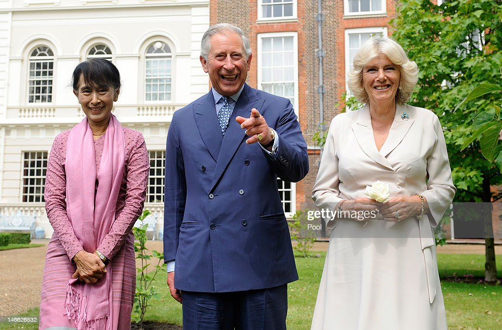 Myanmar opposition leader Aung San Suu Kyi (L) smiles as she meets with Prince Charles, Prince of Wales and Camilla, Duchess of Cornwall before planting a Magnolia tree in the gardens of Clarence House on June 21, 2012 in London, England. The Burmese opposition leader is on a four-day visit to the UK.