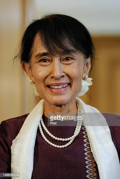 Myanmar opposition leader Aung San Suu Kyi smiles during a press conference with British Prime Minister David Cameron at 10 Downing Street on June 21...