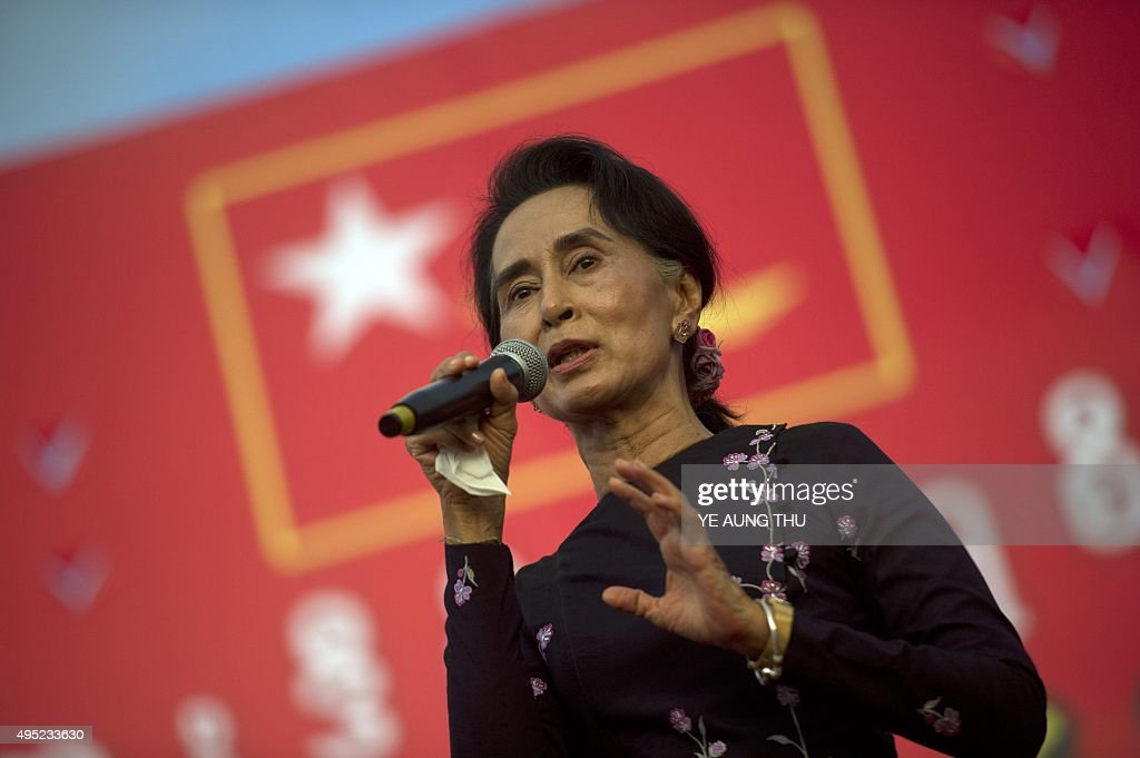 Myanmar opposition leader <a gi-track='captionPersonalityLinkClicked' href=/galleries/search?phrase=Aung+San+Suu+Kyi&family=editorial&specificpeople=214208 ng-click='$event.stopPropagation()'>Aung San Suu Kyi</a> speaks onstage during a campaign rally for the National League for Democracy in Yangon on November 1, 2015. Myanmar heads to the polls on November 8 in what observers and voters hope will be the fairest election in decades as the nation slowly shakes off years of brutal and isolating junta rule. AFP PHOTO / Ye Aung THU