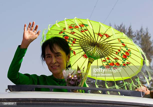 Myanmar opposition leader Aung San Suu Kyi waves from the top of a vehicle during campaigning in the Delta region on her second campaign trip on...