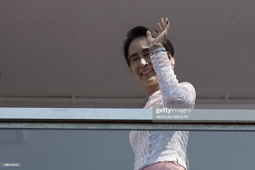 Myanmar opposition leader <a gi-track='captionPersonalityLinkClicked' href=/galleries/search?phrase=Aung+San+Suu+Kyi&family=editorial&specificpeople=214208 ng-click='$event.stopPropagation()'>Aung San Suu Kyi</a> waves to a small crowd and the media after delivering a speech from the balcony of the National League of Democracy (NLD) headquarters in Yangon on November 9, 2015. Vote counting in Myanmar's landmark election was well underway following a massive turnout that could see <a gi-track='captionPersonalityLinkClicked' href=/galleries/search?phrase=Aung+San+Suu+Kyi&family=editorial&specificpeople=214208 ng-click='$event.stopPropagation()'>Aung San Suu Kyi</a>'s party catapulted to power and the end of decades of military control. AFP PHOTO / Nicolas ASFOURI
