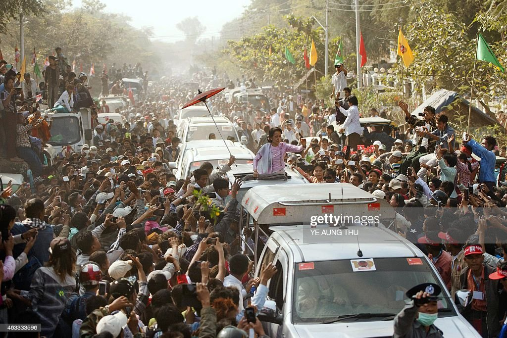 Myanmar opposition leader <a gi-track='captionPersonalityLinkClicked' href=/galleries/search?phrase=Aung+San&family=editorial&specificpeople=812845 ng-click='$event.stopPropagation()'>Aung San</a> Suu Kyi (C) waves to supporters as she leaves celebrations to mark the 100th birthday of the country's independence hero, her father <a gi-track='captionPersonalityLinkClicked' href=/galleries/search?phrase=Aung+San&family=editorial&specificpeople=812845 ng-click='$event.stopPropagation()'>Aung San</a>, in the remote central Myanmar town of Natmauk on February 13, 2015. Myanmar's <a gi-track='captionPersonalityLinkClicked' href=/galleries/search?phrase=Aung+San&family=editorial&specificpeople=812845 ng-click='$event.stopPropagation()'>Aung San</a> Suu Kyi addressed a crowd of thousands in the biggest celebrations honouring her independence hero father in memory, underscoring her legacy months before leading the opposition to momentous elections.