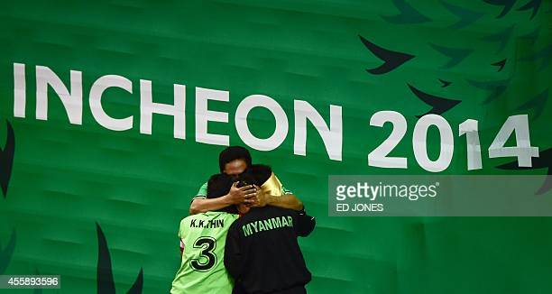 Myanmar players celebrate their win agianst Laos during their Sepaktakraw women's double final game at the Bucheon Gymnasium during the 2014 Incheon...