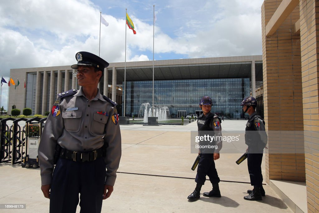 Myanmar Police Force officers stand at the entrance to the Myanmar International Convention Center ahead of the World Economic Forum on East Asia in Naypyidaw, Myanmar, on Wednesday, June 5, 2013. Myanmar hosts the three-day World Economic Forum on East Asia starting today, with heads of state and executives from companies including General Electric Co., Coca-Cola Co. and WPP Plc attending. Photographer: Dario Pignatelli/Bloomberg via Getty Images