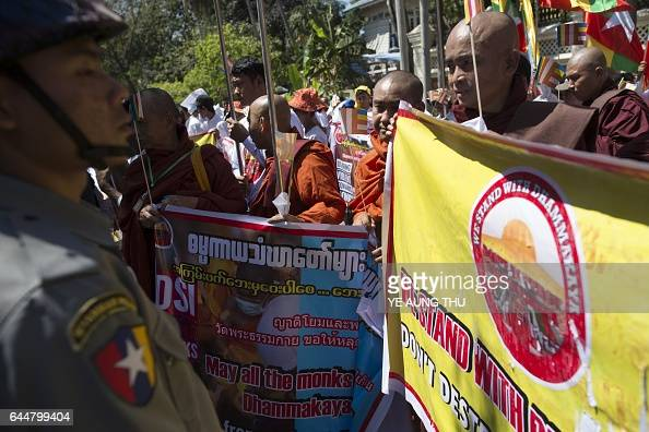 Myanmar police stand guard during a rally by Buddhist nationalists outside the Thai embassy in Yangon on February 24 2017 Myanmar Buddhist...