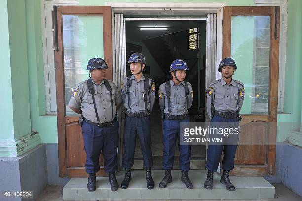 Myanmar police stand guard outside a court during the hearing of Phil Blackwood a New Zealand bar manager at a courtroom in Yangon on January 12 2015...