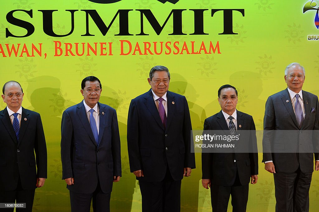 Myanmar President Thein Sein, Cambodian Prime Minister Hun Sen, Indonesia's President Susilo Bambang Yudhoyono, Laos Prime Minister Thongsing Thammavong and Malaysian Prime Minister Najib Razak pose for photos at the 23rd summit of the Association of Southeast Asian Nations (ASEAN) in Bandar Seri Begawan on October 9, 2013. Festering territorial disputes provided the backdrop for an Asian summit kicking off on October 9 with China flexing its diplomatic muscle in the absence of a grounded US President Barack Obama.