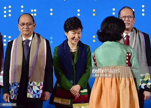 Myanmar President Thein Sein South Korea's President Park GeunHye and Philippines President Benigno Aquino receive scarves during a photo session at...
