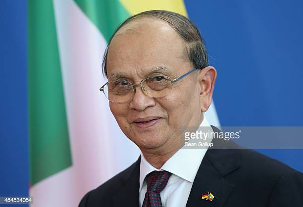 Myanmar President Thein Sein speaks to the media with German Chancellor Angela Merkel following bilateral talks at the Chancellery on September 3...