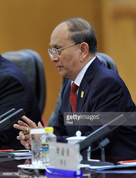Myanmar President Thein Sein speaks with Chinese President Xi Jinping during a meeting at the Great Hall of the People November 8 2014 in Beijing...