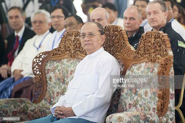 Myanmar President Thein Sein watches a presentation on the Solar Impulse 2 during a press conference at Mandalay international airport on March 20...