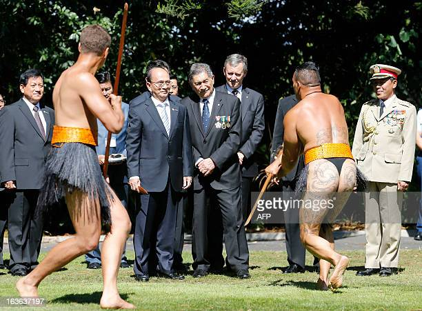 Myanmar President Thein Sein watches Maori warriors while speaking to Government House Kaumatua Lewis Moeau during his official welcome at Government...