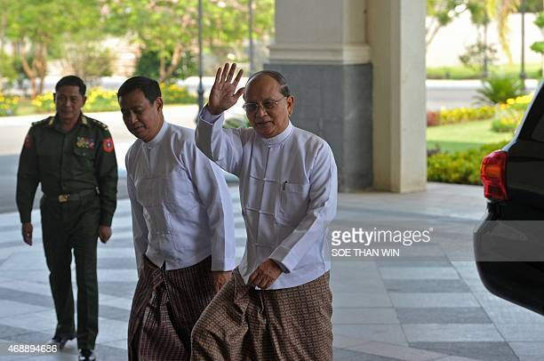 Myanmar President Thein Sein waves hand as he arrives prior to a meeting in Naypyidaw on April 8 2015 Myanmar's president hosted rare talks with...