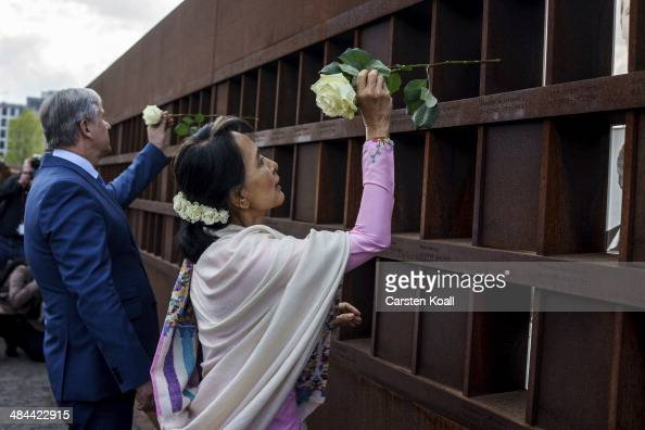Myanmar prodemocracy leader Aung San Suu Kyi and Berlin's Major Klaus Wowereit place flowers on a memorial for victims of the Berlin wall during a...