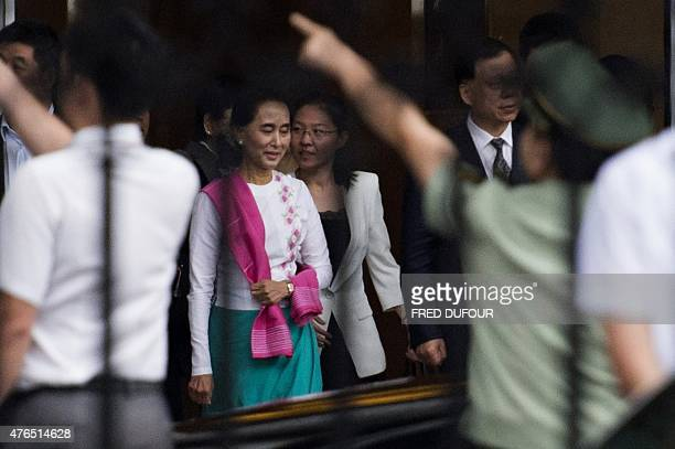 Myanmar prodemocracy leader Aung San Suu Kyi leaves the airport following her arrival in Beijing on June 10 2015 Myanmar opposition leader Aung San...