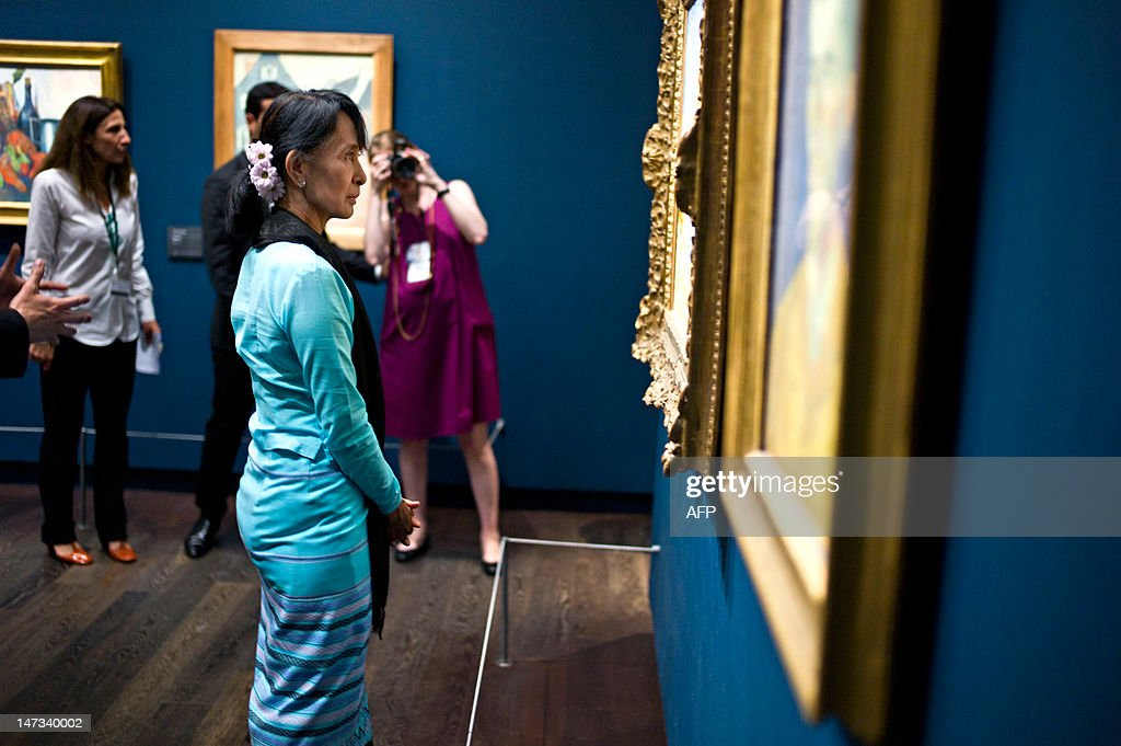 Myanmar pro-democracy leader Aung San Suu Kyi looks a Dutch Vincent Van Gogh's painting as she visits the Orsay museum, in Paris, on June 28, 2012. Myanmar's democracy champion Aung San Suu Kyi is near the end of her triumphant Europe tour in France.