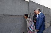 Myanmar prodemocracy leader Aung San Suu Kyi looks through the wall when Director of the Berlin Wall Memorial Axel Klausmeier and Berlin's Mayor...