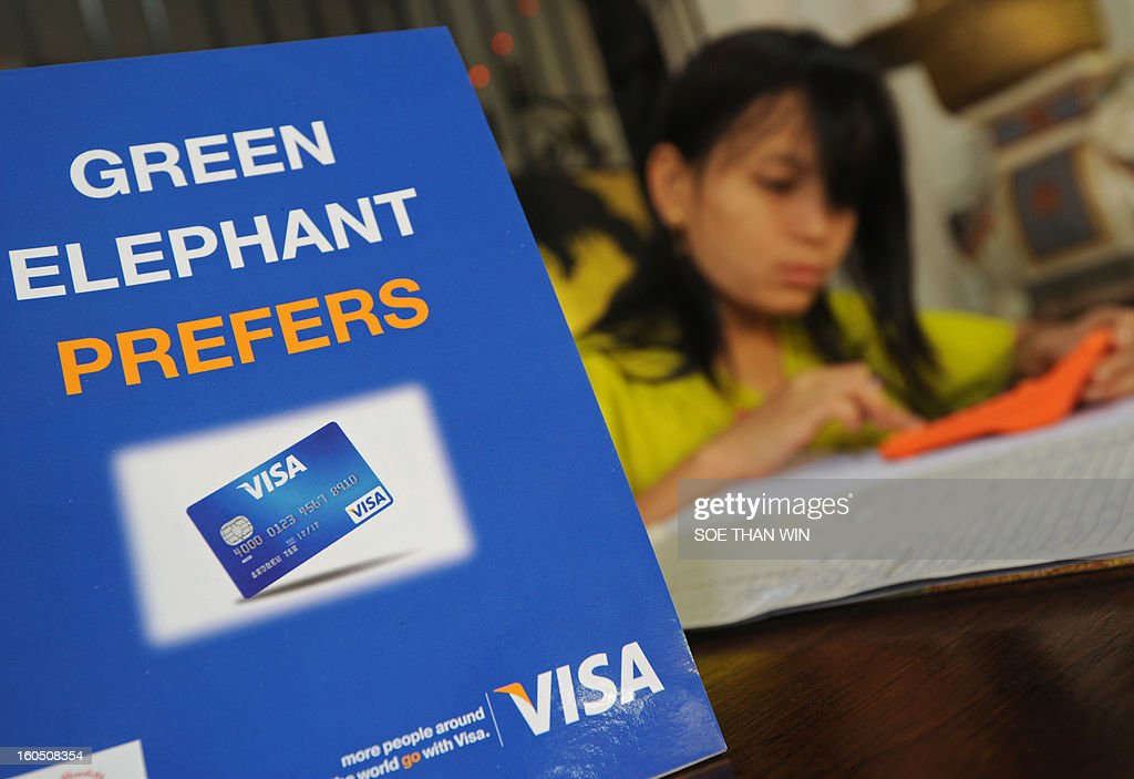 A Myanmar receptanist works at a restaurant which accepts Visa electronic payment following the US credit card giant Visa's launch in Myanmar, marking the long-awaited debut of plastic in a country that until now has had a cash economy, in Yangon on February 2, 2013. AFP PHOTO/Soe Than WIN