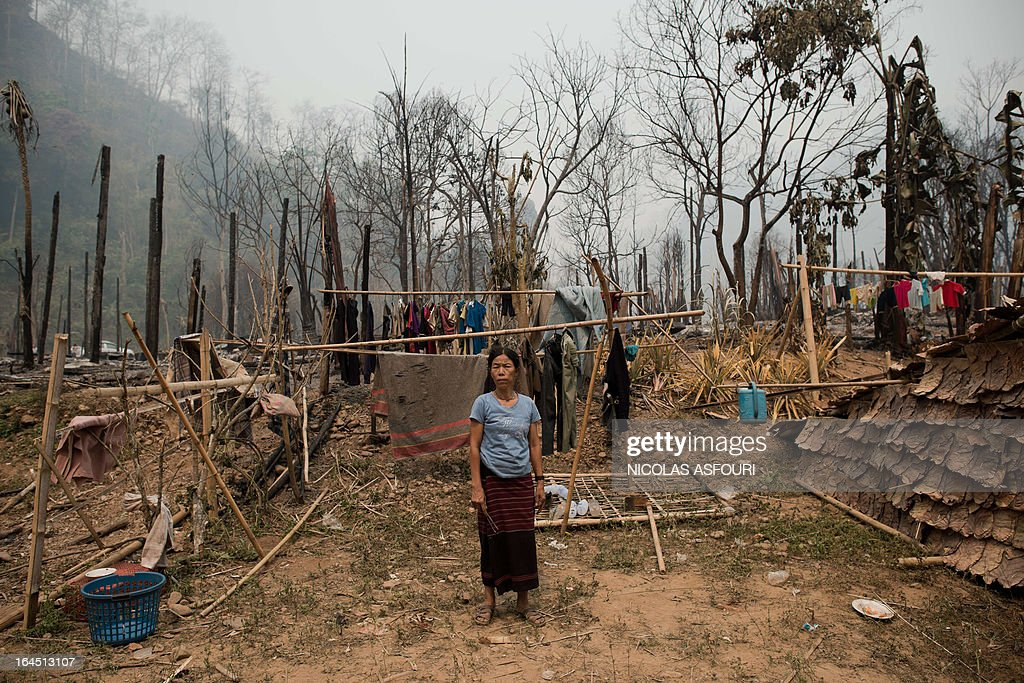 A Myanmar refugee stands inside the perimeter of her under-construction shack at the Mae Surin camp in Mae Hong Son province on March 24, 2013. Thai rescue workers picked through the ashes of hundreds of shelters for Myanmar refugees, after a ferocious blaze swept through a camp in northern Thailand killing 35 people. Around 100 people were injured in Friday's fire at the Mae Surin camp in Mae Hong Son province, provincial governor Narumol Paravat told AFP by telephone, giving a reduced toll from the 45 dead previously stated. AFP PHOTO/ Nicolas ASFOURI