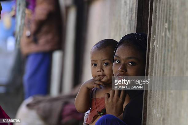 Myanmar Rohingya refugees look on in a refugee camp in Teknaf in Bangladesh's Cox's Bazar on November 26 2016 Thousands of desperate Rohingya a...