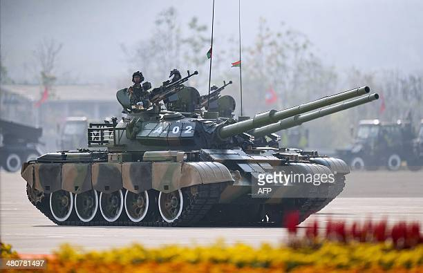 Myanmar soldier ride on top of a tank during a ceremony to mark the 69th anniversary of Armed Forces Day in Myanmar's capital Naypyidaw on March 27...