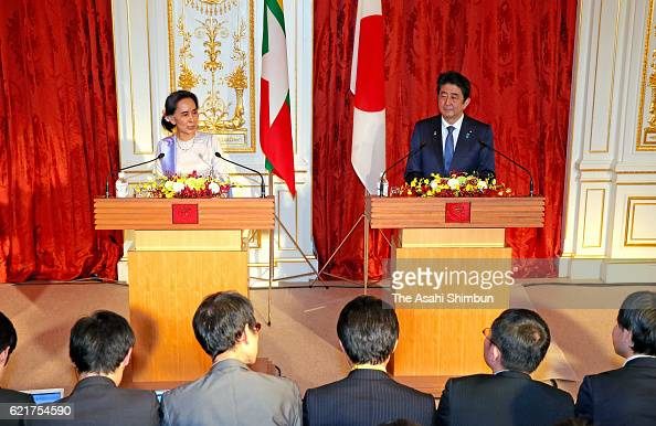 Myanmar State Counsellor and Foreign Minister Aung San Suu Kyi and Japanese Prime Minister Shinzo Abe attend a joint press conference following their...