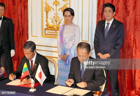 Myanmar State Counsellor and Foreign Minister Aung San Suu Kyi and Japanese Prime Minister Shinzo Abe attend a signing ceremony following their...
