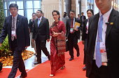 Myanmar State Counsellor and Foreign Minister Aung San Suu Kyi walks inside the main venue during the 49th annual miniterial meeting of the South...