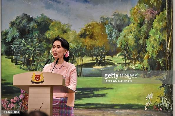 Myanmar State Counsellor Aung San Suu Kyi delivers her speech during a dinner function hosted by Singapore Prime Minister Lee Hsien Loong at the...
