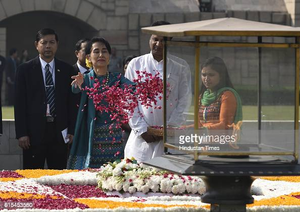 Myanmar State Counsellor Aung San Suu Kyi paying tribute to the Mahatma Gandhi at his memorial at Raj Ghat on October 18 2016 in New Delhi India The...