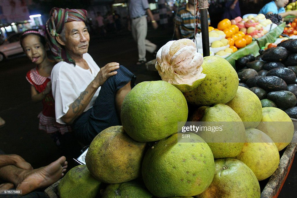 A Myanmar vendor waits for customers at a street market in Yangon on March 8 2010 AFP PHOTO