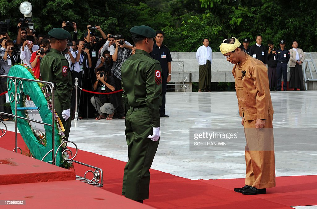 Myanmar Vice President Sai Mauk Kham bows in honour of independence hero General Aung San and eight other leaders who were assassinated on July 19, 1947, as Myanmar marks the 66th anniversary of Martyrs' Day in Yangon on July 19, 2013. AFP PHOTO/Soe Than WIN