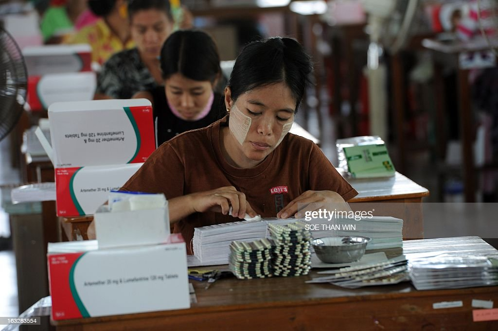 A Myanmar worker prepares to pack medicine pills delivered into the country by the United States Agency for International Development (USAID) at a warehouse in Yangon on March 7, 2013. USAID administrator Rajiv Shah is on an official visit to Myanmar. AFP PHOTO/ Soe Than WIN