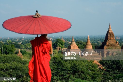 Myanmar: Young Monk Overlooks Bagan Temples