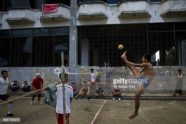 Myanmar youths play sepak takraw also known locally as chinlone in Yangon on October 22 2015 AFP PHOTO / Ye Aung THU