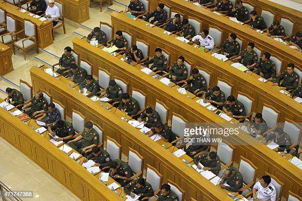 MyanmarpoliticsmilitaryFEATURE by Nan Tin Htwe This photo taken on April 9 2015 shows military members of parliament attend the union parliament...