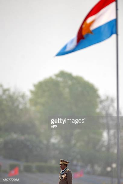 Myanmar's army chief Senior General Min Aung Hlaing attends a ceremony after inspecting troops to mark the 69th anniversary of Armed Forces Day in...