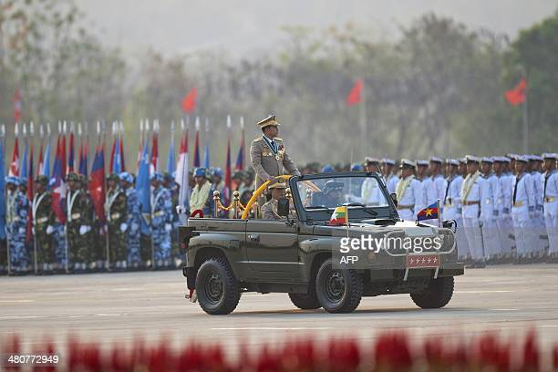 Myanmar's army chief Senior General Min Aung Hlaing inspects troops during a parade to mark the 69th anniversary of Armed Forces Day in Myanmar's...