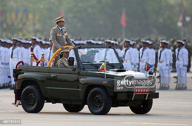 Myanmar's army chief Senior General Min Aung Hlaing inspects troops during a ceremony to mark the 69th anniversary of Armed Forces Day in Myanmar's...