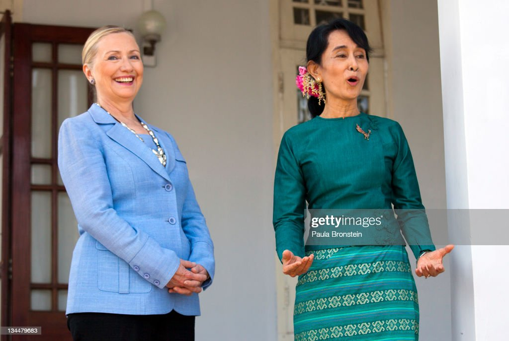 Myanmar's democracy leader <a gi-track='captionPersonalityLinkClicked' href=/galleries/search?phrase=Aung+San+Suu+Kyi&family=editorial&specificpeople=214208 ng-click='$event.stopPropagation()'>Aung San Suu Kyi</a> speaks along side U.S Secretary of State <a gi-track='captionPersonalityLinkClicked' href=/galleries/search?phrase=Hillary+Clinton&family=editorial&specificpeople=76480 ng-click='$event.stopPropagation()'>Hillary Clinton</a> during a press conference after their meeting at Suu Kyi's residence laying out a framework for reforms on December 2, 2011 in Yangon, Myanmar. The pace of change in Myanmar has brought U.S Secretary of State <a gi-track='captionPersonalityLinkClicked' href=/galleries/search?phrase=Hillary+Clinton&family=editorial&specificpeople=76480 ng-click='$event.stopPropagation()'>Hillary Clinton</a>'s visit which is the first in over a half a century. In March the army handed power to a civilian government after almost five decades of military regime's strong arm rule. The handover took place after a controlled election under a new constitution that preserved much of the military clout. Internet has been loosened up as inaccessible foreign news and opposition websites have been unblocked.