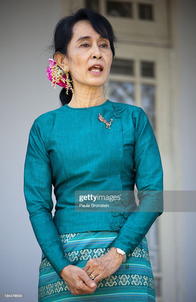 Myanmar's democracy leader <a gi-track='captionPersonalityLinkClicked' href=/galleries/search?phrase=Aung+San+Suu+Kyi&family=editorial&specificpeople=214208 ng-click='$event.stopPropagation()'>Aung San Suu Kyi</a> speaks during a press conference along side U.S Secretary of State Hillary Clinton outside Suu Kyi's residence December 2nd, 2011 in Yangon, Myanmar. The pace of change in Myanmar has brought U.S Secretary of State Hillary Clinton's visit which is the first in over a half a century. In March the army handed power to a civilian government after almost five decades of military regime's strong arm rule. The handover took place after a controlled election under a new constitution that preserved much of the military clout. Internet has been loosened up as inaccessible foreign news and opposition websites have been unblocked.