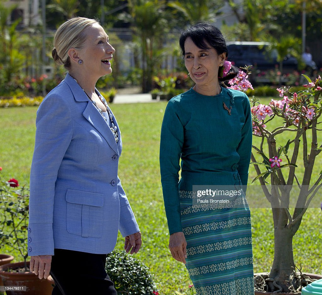 Myanmar's democracy leader <a gi-track='captionPersonalityLinkClicked' href=/galleries/search?phrase=Aung+San+Suu+Kyi&family=editorial&specificpeople=214208 ng-click='$event.stopPropagation()'>Aung San Suu Kyi</a> walks along side U.S Secretary of State <a gi-track='captionPersonalityLinkClicked' href=/galleries/search?phrase=Hillary+Clinton&family=editorial&specificpeople=76480 ng-click='$event.stopPropagation()'>Hillary Clinton</a> in the garden outside Suu Kyi's residence after their meeting laying out a framework for reforms on December 2, 2011 in Yangon, Myanmar. The pace of change in Myanmar has brought U.S Secretary of State <a gi-track='captionPersonalityLinkClicked' href=/galleries/search?phrase=Hillary+Clinton&family=editorial&specificpeople=76480 ng-click='$event.stopPropagation()'>Hillary Clinton</a>'s visit which is the first in over a half a century. In March the army handed power to a civilian government after almost five decades of military regime's strong arm rule. The handover took place after a controlled election under a new constitution that preserved much of the military clout. Internet has been loosened up as inaccessible foreign news and opposition websites have been unblocked.