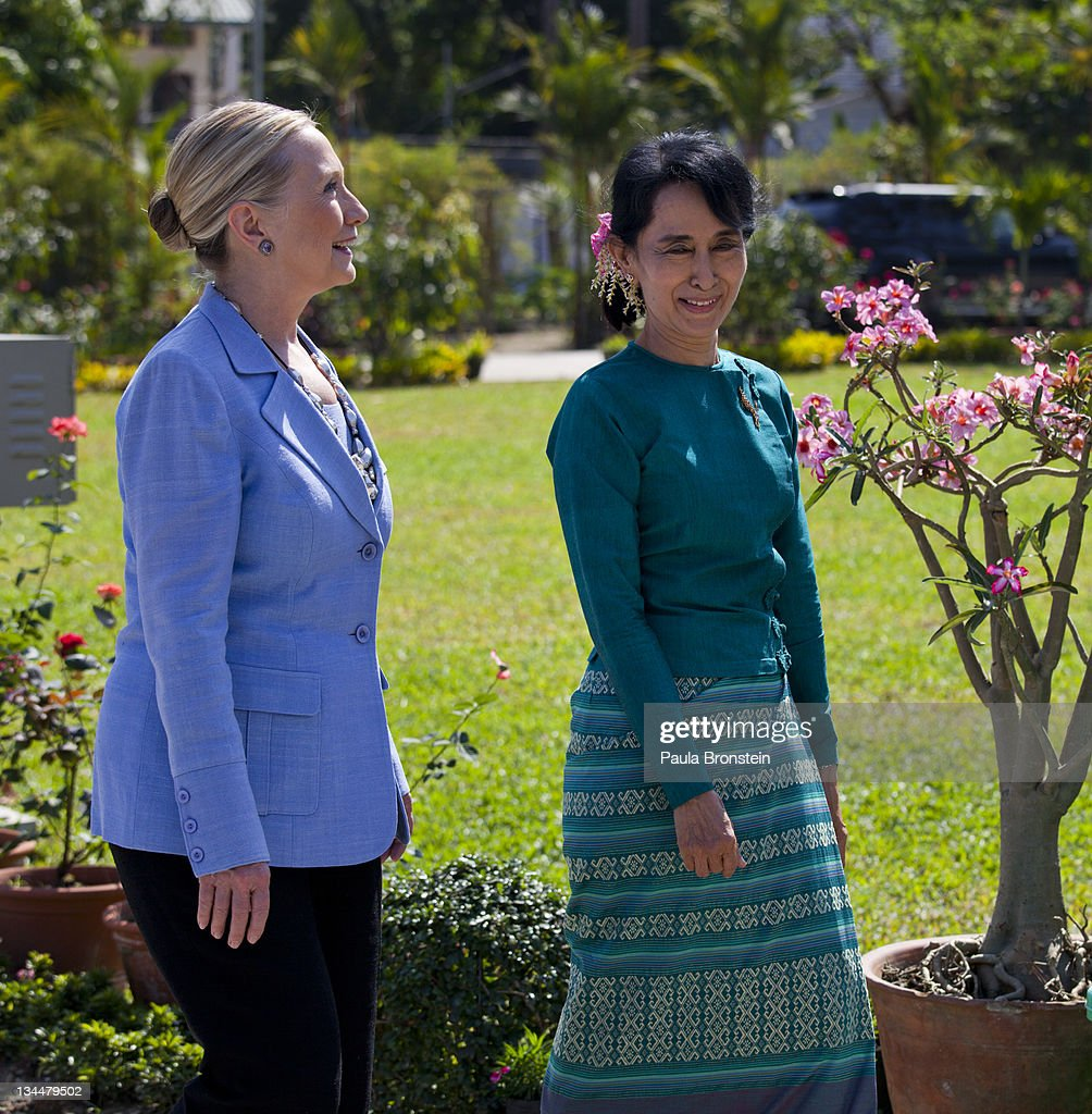 Myanmar's democracy leader <a gi-track='captionPersonalityLinkClicked' href=/galleries/search?phrase=Aung+San+Suu+Kyi&family=editorial&specificpeople=214208 ng-click='$event.stopPropagation()'>Aung San Suu Kyi</a> walks along side U.S Secretary of State <a gi-track='captionPersonalityLinkClicked' href=/galleries/search?phrase=Hillary+Clinton&family=editorial&specificpeople=76480 ng-click='$event.stopPropagation()'>Hillary Clinton</a> in the garden outside Suu Kyi's residence after their meeting laying out a framework for reforms December 2nd, 2011 in Yangon, Myanmar. The pace of change in Myanmar has brought U.S Secretary of State <a gi-track='captionPersonalityLinkClicked' href=/galleries/search?phrase=Hillary+Clinton&family=editorial&specificpeople=76480 ng-click='$event.stopPropagation()'>Hillary Clinton</a>'s visit which is the first in over a half a century. In March the army handed power to a civilian government after almost five decades of military regime's strong arm rule. The handover took place after a controlled election under a new constitution that preserved much of the military clout. Internet has been loosened up as inaccessible foreign news and opposition websites have been unblocked.