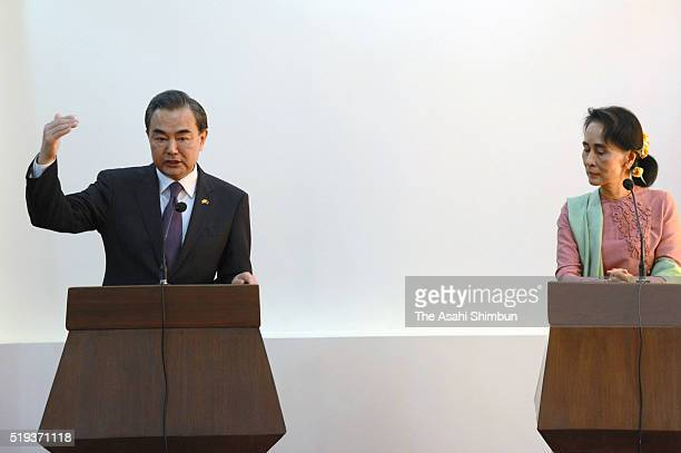 Myanmar's new Foreign Minister Aung San Suu Kyi and Chinese Foreign Minister Wang Yi attend a joint press conference after their meeting at the...