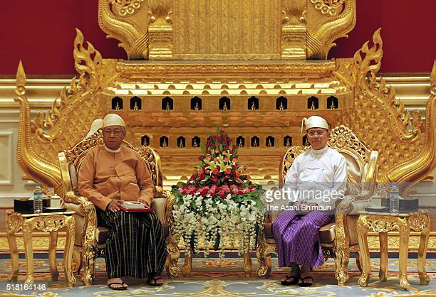 Myanmar's new president Htin Kyaw and outgoing president Thein Sein attend a handover ceremony on March 30 2016 in Naypyitaw Myanmar
