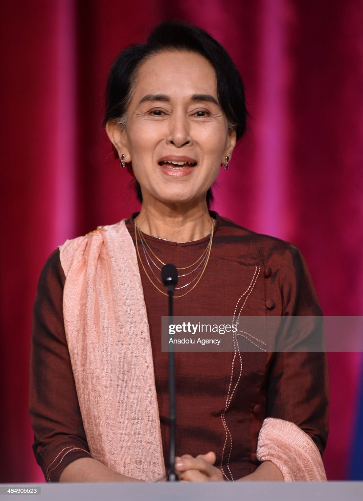 Myanmar's opposition leader and Nobel prize winner Aung San Suu Kyi speaks during a joint press conference with French President Francois Hollande (not seen) following their meeting at the Elysee Palace on April 15, 2014 in Paris, France.