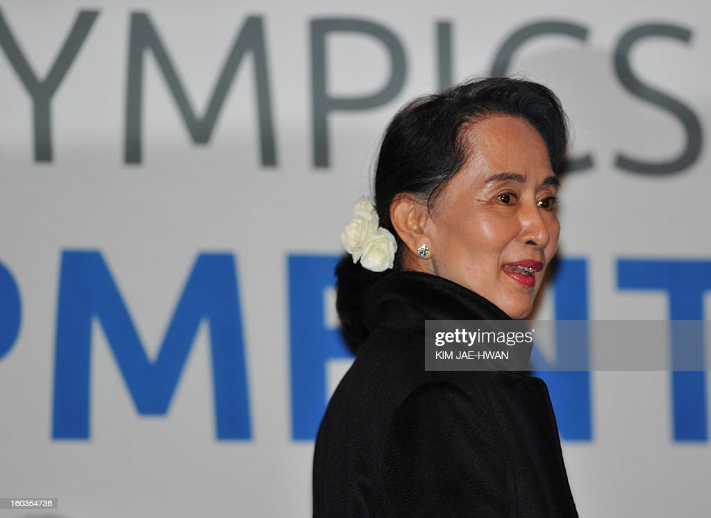 Myanmar's opposition leader Aung San Suu Kyi leaves after a press conference of The Global Development Summit, held on the sidelines of the 10th Special Olympics World Winter Games in Pyeongchang, about 180 km east of Seoul on January 30, 2013. The democracy leader and Nobel peace laureate was a guest of honour at the opening of the Special Winter Olympics in the northeastern mountain resort of Pyeongchang -- the site of the full 2018 Winter Games.